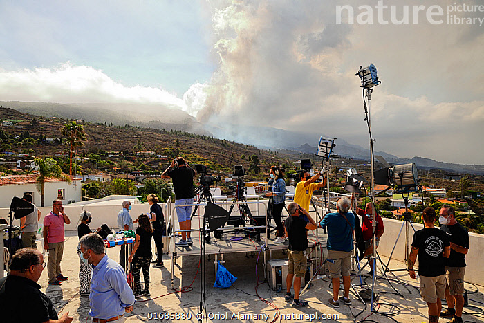 Television crews broadcasting the Cumbre Vieja volcano eruption from El Paso, La Palma, Canary Islands, September 2021.  ,  Capturing An Image,Filming,Erupting,Working,People,Crew,Media Event,Broadcasting,Channel,Channels,Europe,Southern Europe,Equipment,Communication Equipment,Ash,Ashes,Island,Islands,Volcano,Smoke,The Media,Media,News,Publicity,Geology,Volcanic features,Atlantic Islands,Mediterranean Basin,Mediterranean,Biodiversity hotspot,Phenomenon,Volcanic Ash,Natural Phenomenon,  ,  Oriol  Alamany