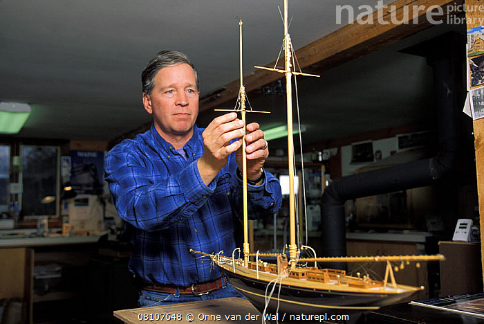 "Model boat builder, Robert Eddy, working on the mast of a scale model of the 1915 Herreshoff schooner ""Mariette"" in his shop in Camden, Maine, USA., boatbuilding,boat-building,BOATS,CONCENTRATION,craft,craftsman,HISTORICAL,MAN,MODELS,NORTH-AMERICA,SAILING-BOATS,SCALE,SCHOONERS,USA,YACHTS, SAILING-BOATS ,North America, SAILING-BOATS ,PEOPLE, Onne van der Wal"