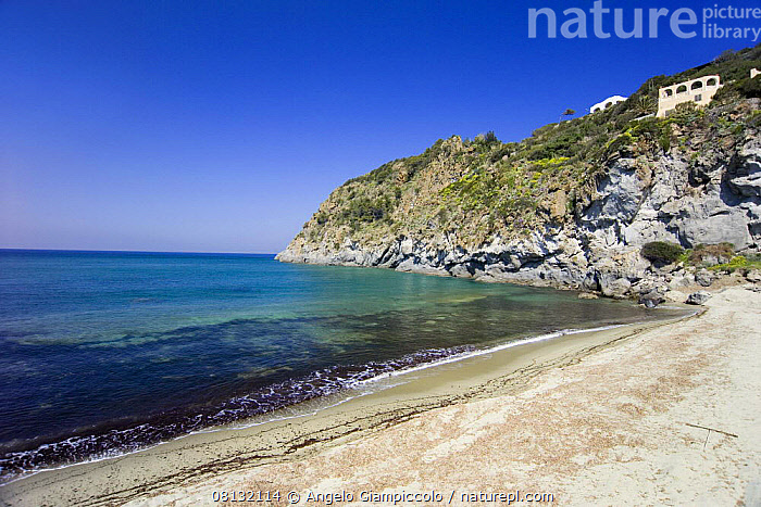 Deserted Forio beach on a clear day, Ischia, Bay of Naples, Italy.  ,  ASPIRATIONS,BEACHES,CLIFFS,COASTS,EMPTY,EUROPE,ITALY,LANDSCAPES,MEDITERRANEAN,PEACEFUL,Concepts,Geology  ,  Angelo Giampiccolo