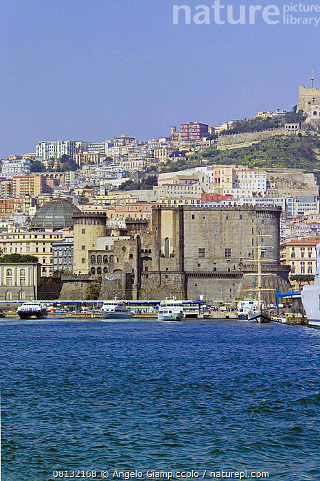 """View of Naples with the """"Maschio Angioino"""" fortress in the foreground, Italy.  ,  VERTICAL,BOATS,BUILDINGS,CASTLES,CITIES,COASTS,CRUISING,EUROPE,FORT,FORTS,ITALY,MEDITERRANEAN,MOORED,MOTORBOATS,TOWNS,YACHTS  ,  Angelo Giampiccolo"""