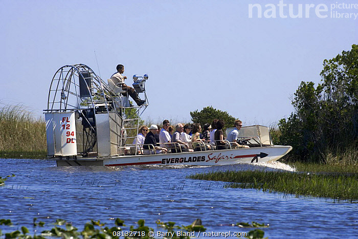 Air boat tourist trip, the Everglades, Florida, USA.  ,  air,BOATS,Everglades,Florida,GREEN,natural,nature,PEOPLE,seeing,sight,swamp,tourists,TREES,USA,Visitors,world,PLANTS,North America  ,  Barry Bland