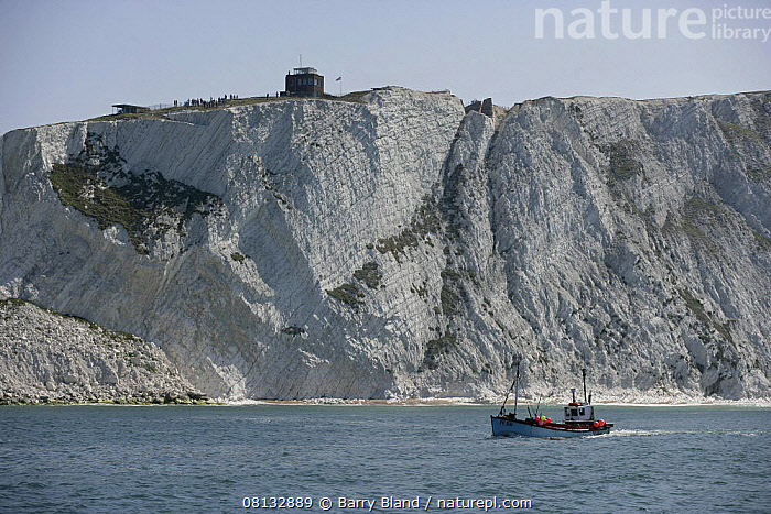 A fishing boat cruising alongside the white cliffs that lead to The Needles, Isle of Wight, England, UK. The Needles Old Battery can be seen on top of the cliff, as can the look out post (far left), reached through a tunnel, which offers a unique panorama of The Needles.  ,  UK,BOATS,CLIFFS,COASTS,ENGLAND,EUROPE,FISHING,FISHING-BOATS,isle-of-wight,PROFILE,ROCKS,UK,Geology, United Kingdom, United Kingdom, United Kingdom,WORKING-BOATS  ,  Barry Bland