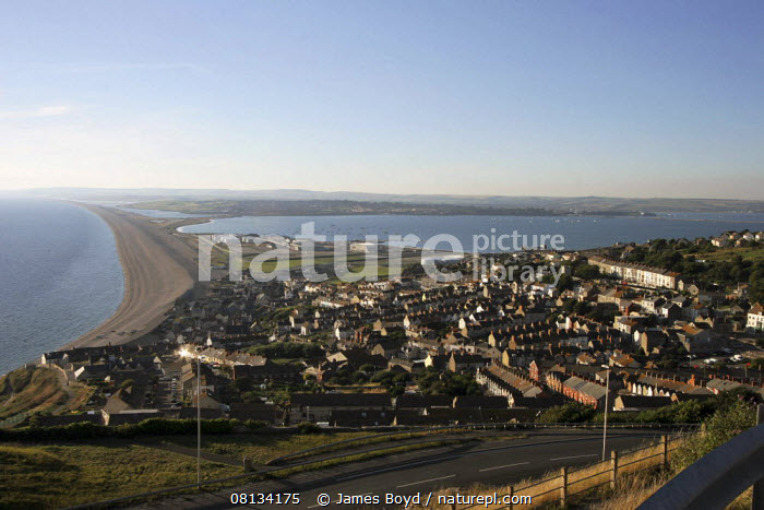 View of Chesil beach and causeway, looking north from Portland, Dorset, England.  ,  ATLANTIC OCEAN,BEACHES,COASTS,ENGLAND,EUROPE,GEOLOGY,LANDSCAPES,TEMPERATE,TOWNS,UK,Marine, United Kingdom, United Kingdom  ,  James Boyd