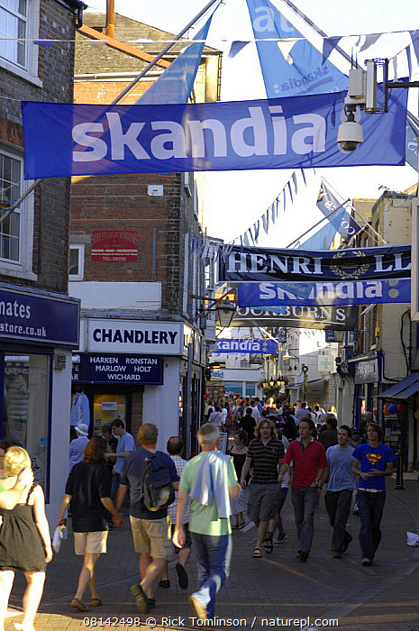 High Street during Skandia Cowes Week, Solent, UK day 2, Sunday August 5, 2007., VERTICAL,ADVERTISING,BUILDINGS,ENGLAND,EUROPE,EVENTS,ISLE OF WIGHT,PEOPLE,TEXT,TOWNS,UK, United Kingdom, United Kingdom, Rick Tomlinson