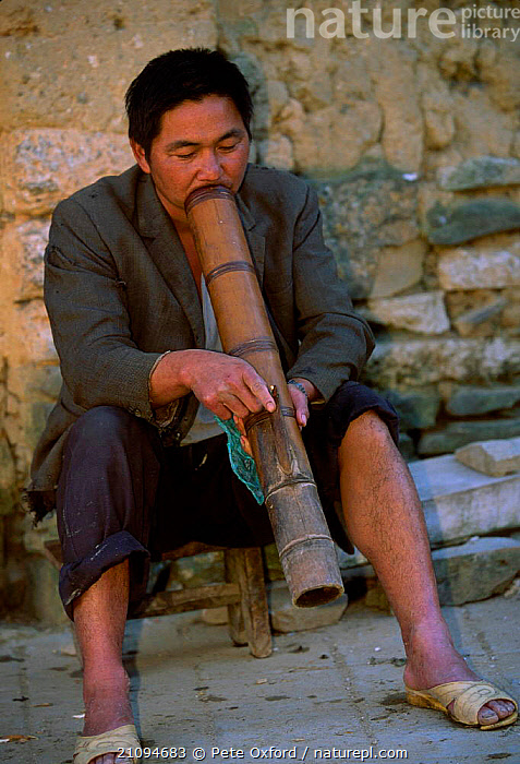 Man smoking traditional pipe Yi group ethnic minority Yunnan, China  ,  PIPES,MALE,ASIA,TRIBES,PEOPLE,CHINA  ,  Pete Oxford