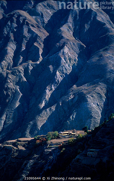 Tibetan village on side of mountain Yunnan, China, LANDSCAPES,MOUNTAINS,DRAMATIC,VILLAGES,SUMMER,Asia,CHINA,Catalogue1, Xi Zhinong