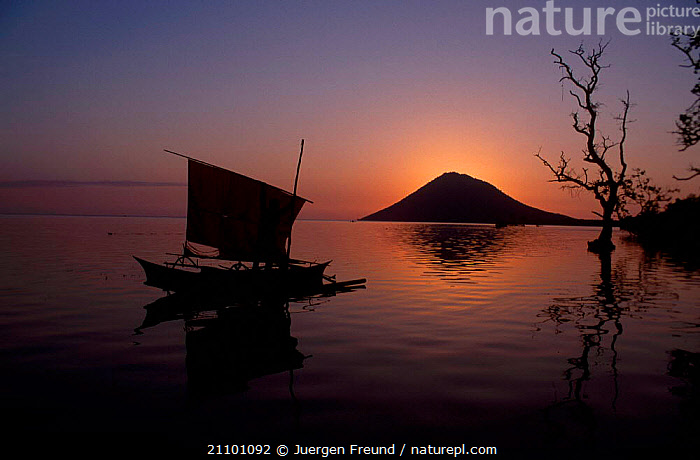 Fishing boat at sunset with Manado Tua volcano in background Bunaken Indonesia, PEACEFUL,ASIA,SOUTH EAST ASIA,TRADITIONAL,SEA,LANDSCAPES,VOLCANOES,BOATS,SILHOUETTES,CONCEPTS,GEOLOGY,SOUTH-EAST-ASIA, Jurgen Freund