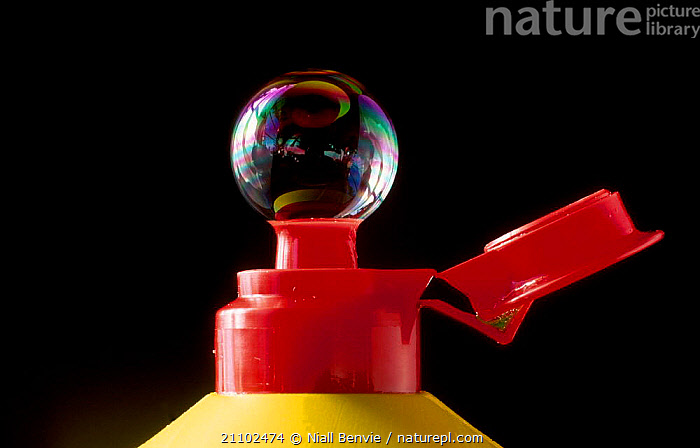 Detergent bubble on detergent bottle. UK, BOTTLE,POLLUTION,POLLUTANT,AIR,CHEMICAL, Niall Benvie