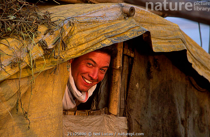 Jonny Keeling peering out of tent. Assistant Producer Life of Mammals. India. 2002, MAMMALS,NHU,ASIA,LIFE OF MAMMALS,INDIA,TENT,PEOPLE,CAMPING,INDIAN SUBCONTINENT,TENTS, Neil Lucas
