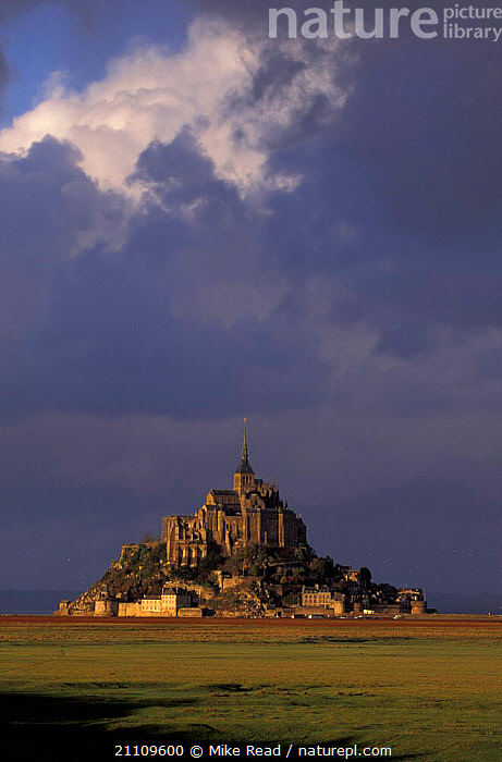 Mont St Michel in evening light with storm clouds behind Normandy France  ,  ISLAND,LANDMARK,HISTORIC,LANDSCAPES,SUNSET,Europe  ,  Mike Read