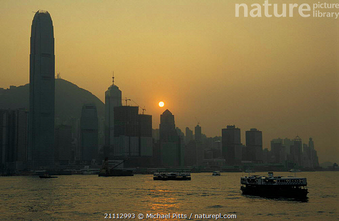 Hong Kong Island with Victoria harbour in foreground China  ,  BOATS,LANDSCAPES,FERRIES,FERRY,HONG KONG,SUNRISE,CITIES,BUILDINGS,SKYSCRAPERS,ASIA, WORKING-BOATS ,CHINA, WORKING-BOATS  ,  Michael Pitts