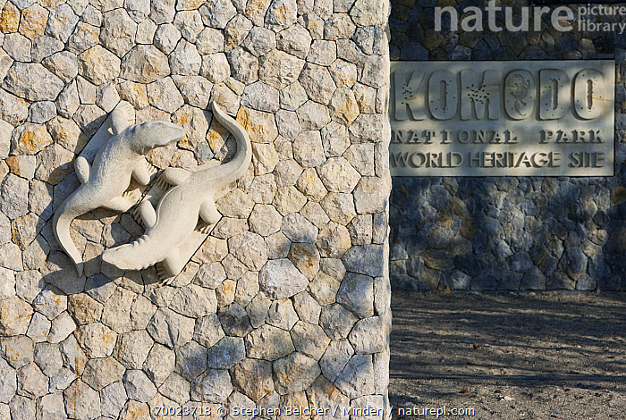 Sign and sculpture at Komodo National Park entrance, Komodo Island, Komodo National Park, Indonesia  ,  Color Image, Day, Horizontal, Indonesia, Komodo Island, Komodo National Park, Lizard, Nobody, Outdoors, Photography, Sculpted, Sculpture, Sign, Wall, World Heritage Site,Indonesia  ,  Stephen Belcher