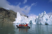 Glacier with tourist expedition in inflatable zodiac, southern Greenland Fjords, Greenland  -  Tui De Roy