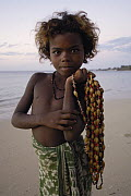 Child selling necklaces on the beach made from seeds and shells found locally, Mangily, near Ifaty, southwestern Madagascar  -  Pete Oxford