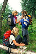 Children reading map while hiking, Belgium  -  Philippe Clement