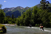People crossing a river on horses in the Arkhyz valley, the western part of the Teberdinsky Biosphere reserve, Caucasus, Russia, July 2008 (Model released) - Wild Wonders of Europe / Schandy