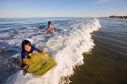 Children on boogie boards at Hampton Beach, New Hampshire, USA, August 2008. Model released. - Jerry Monkman