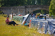 Man relaxing on chair next to his barge, River Thames at Lechlade, Gloucestershire, July 2008.  -  Nick Turner