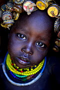 Dassanech baby with her headdress made from bottlecaps, Lower Omo Valley. Ethiopia, November 2014  -  Enrique Lopez-Tapia