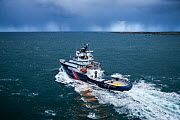 Tug 'Abeille Bourbon' with rains clouds on the horizon, Iroise Sea, Brest, Brittany, France, April 2005. All non-editorial uses must be cleared individually.  -  Benoit  Stichelbaut