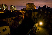 Urban Red fox (Vulpes vulpes)  searching for food near bins in a courtyard at night, West London, United Kingdom, May 2014. Finalist in the Urban category of the Wildlife Photographer of the Year Awar... - Neil Aldridge