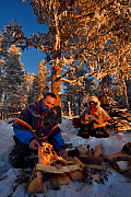 Nils-Torbjorn Nutti, owner and operator at Nutti Sami Siida, and Klara Enbom-Burreau on snowmobile trip into the wilderness, Jukkasjarvi, Lapland, Laponia, Norrbotten county, Sweden Model released. - Staffan Widstrand