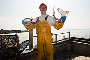 Fisherman holding two Catsharks as bycatch from a lobster pot, Lamlash Bay, South Arran Marine Protected Area, Isle of Arran, Scotland, UK, August.  -  SCOTLAND: The Big Picture