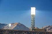 Sun rays reflected onto solar tower at Ivanpah Solar Thermal Power Plant,  the largest solar thermal plant in the world. It covers 4,000 acres of desert and produce 392 megawatts (MW) of electricity.... - Ashley Cooper