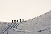 Climbers on the arete leading up from the Vallee Blanche to the Aiguille Du Midi above Chamonix, France. September 2014 - Ashley Cooper