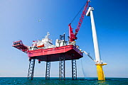 The Krakken, a jack up barge, constructing wind turbines of the Walney offshore wind farm, lifts a nacelle into place. Cumbria, England, UK. September 2011 - Ashley Cooper