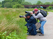 Photographer Oliver Hellowell taking pictures, balancing the camera on the head of photographer Mike O'Carroll, England, UK. June 2017.  -  Oliver Hellowell