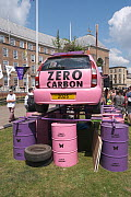 Pink car emblazoned with 'Zero carbon', on top of oil drums. Extinction Rebellion climate change rally. Bristol, England, UK. 16 July 2019.  -  Ben Gillett