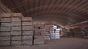 Warehouse containing finished tinished timber cut from the Amazon rainforest, Brazil, June 2019.  -  Laurie Hedges