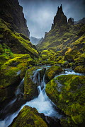 Landscape of Thakgil canyon, with waterfall and jagged mountains, Iceland, September. - Guy Edwardes