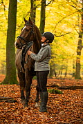 Horse rider in Wilverley Wood New Forest National Park, Hampshire, England, UK. November 2018.